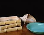 Justine Reyes: Still Life with Drawers, Plate and Conch Shell