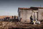 Michele Palazzi & Alessandro Penso: A Migrant Washing his Clothes, Basilicata, Italy