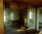 Steve Fitch: Living room with a mirror wall in a house near Lefors, Texas, March 20,1998